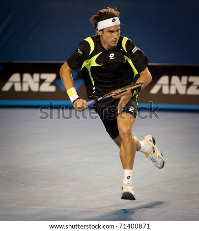 MELBOURNE - JANUARY 28: David Ferrer of Spain in his semi-final loss to Andy Murray of Great Britain in the 2011 Australian Open on January 28, 2011 in Melbourne, Australia. - stock photo