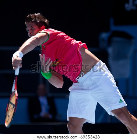 MELBOURNE - JANUARY 19: Fernando Verdasco of Spain in his second  round win over Janko Tipsarevic of Serbia in the 2011 Australian Open - January 19, 2011 in Melbourne