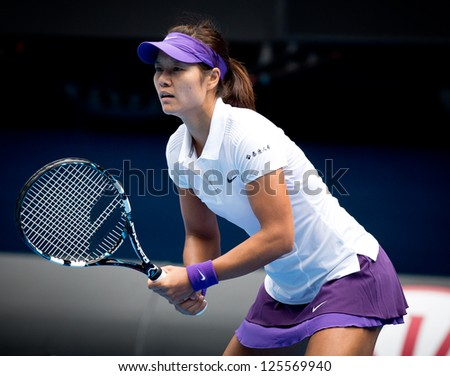 MELBOURNE - JANUARY 22: Li Na of China in her quarter final win over Agnieszka Radwanska of Poland at the 2013 Australian Open on January 22, 2013 in Melbourne, Australia.