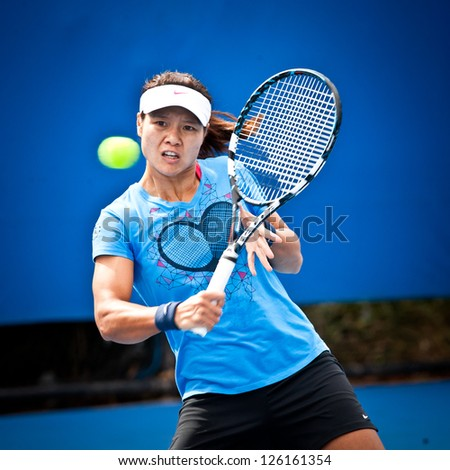 MELBOURNE - JANUARY 26: Li Na of China practices before the final at the 2013 Australian Open on January26, 2013 in Melbourne, Australia. - stock photo
