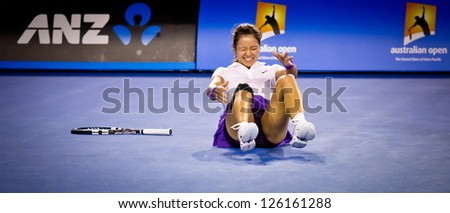 MELBOURNE - JANUARY 26: Li Na of Chins injures her ankle in the 2013 Australian Open Womens Final on January26, 2013 in Melbourne, Australia. - stock photo