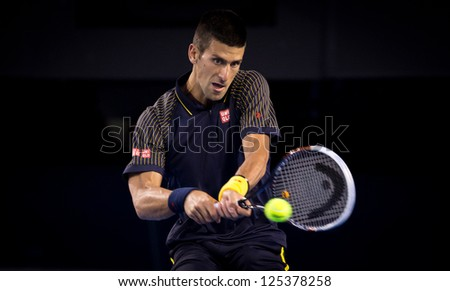 MELBOURNE - JANUARY 20: Novak Djokovic of Serbia in his marathon fourth round win over Stanislas Wawrinka at the 2013 Australian Open on January 20, 2013 in Melbourne, Australia. - stock photo