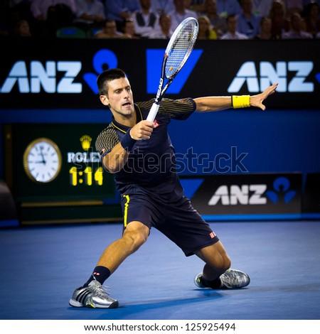 MELBOURNE - JANUARY 24: Novak Djokovic of Serbia in his semi final win over David Ferrer of Spain at the 2013 Australian Open on January 24, 2013 in Melbourne, Australia. - stock photo