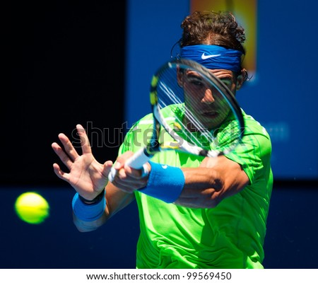 MELBOURNE - JANUARY 18: Rafael Nadal of Spain in his second round win over Tommy Haas of Germany at the 2012 Australian Open on January 18, 2012 in Melbourne, Australia. - stock photo