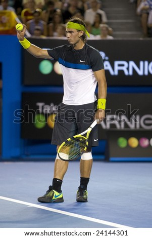 MELBOURNE - JANUARY 28: Rafael Nadal of Spain shows the new ball at the Australian Open Tennis Grand Slam Event on January 28, 2009 in Melbourne. - stock photo