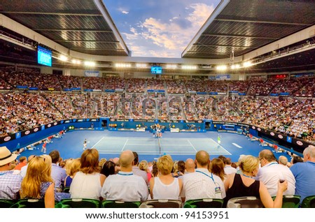 MELBOURNE - JANUARY 29: Rod Laver arena during the 2012 Australian Open final between Noval Djokavic of Serbia and Rafael Nadal of Spain on January 29, 2012 in Melbourne, Australia. - stock photo