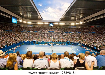 MELBOURNE - JANUARY 29: Rod Laver arena during the epic 2012 Australian Open final between Noval Djokavic of Serbia and Rafael Nadal of Spain on January 29, 2012 in Melbourne, Australia. - stock photo
