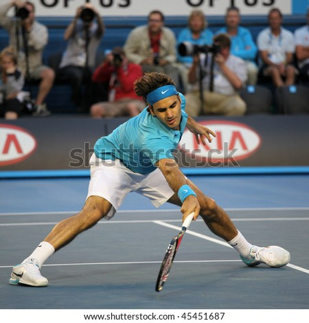 MELBOURNE - JANUARY 27: Roger Federer in action at his win over Nikolay Davydenko during a quarter final match in the 2010 Australian Open on January 27, 2010 in Melbourne - stock photo