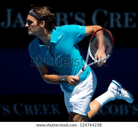 MELBOURNE - JANUARY 15: Roger federer of Switzerland in his first round win over Benoit Paire of France at the 2013 Australian Open on January 15, 2013 in Melbourne, Australia.