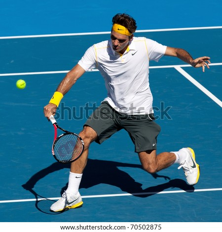 MELBOURNE - JANUARY 23: Roger Federer of Switzerland in his fourth round win over Tommy Robredo of Spain in the 2011 Australian Open on January 23, 2011 in Melbourne, Australia. - stock photo