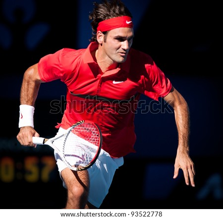 MELBOURNE - JANUARY 24: Roger Federer of Switzerland in his quarter final win over Juan martin del portro at the 2012 Australian Open on January 24, 2012 in Melbourne, Australia. - stock photo