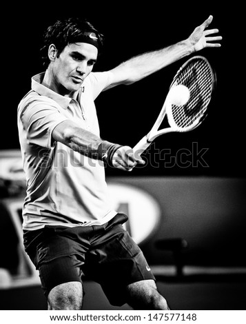 MELBOURNE - JANUARY 19:  Roger Federer of Switzerland in his third round win over Berbard Tomic of Australia at the 2013 Australian Open on January 19, 2013 in Melbourne, Australia. - stock photo