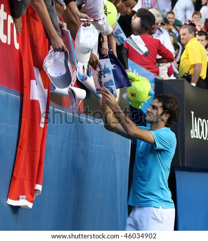 MELBOURNE - JANUARY 27: Roger Federer signs autographs after his win over Nikolay Davydenko during a quarter final match in the 2010 Australian Open on January 27, 2010 in Melbourne - stock photo