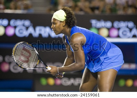MELBOURNE - JANUARY 28: Serena Williams of the USA waits for a serve at the Australian Open Tennis Grand Slam Event on January 28, 2009 in Melbourne.