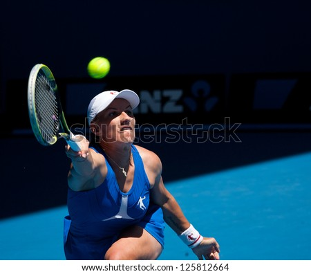 MELBOURNE - JANUARY 23: Svetlana Kuznetsova of Russia in her quarter final loss to Victoria Azarenka of Belarus   at the 2013 Australian Open on January 23, 2013 in Melbourne, Australia. - stock photo