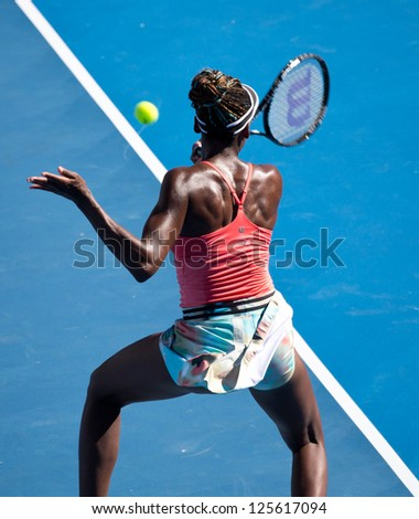 MELBOURNE - JANUARY 22: Venus Williams of the USA in a doubles match at the 2013 Australian Open on January 22, 2013 in Melbourne, Australia.