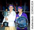 MELBOURNE - JANUARY 26: Victoria Azarenka (L) of Belarus with runner-up Li Na of China and the trophy for winning the 2013 Australian Open on January26, 2013 in Melbourne, Australia. - stock photo