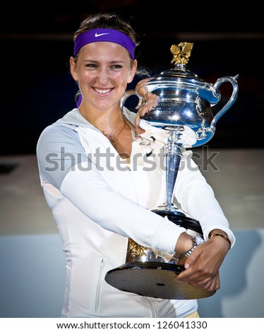 MELBOURNE - JANUARY 26: Victoria Azarenka of Belarus with the trophy for winning the 2013 Australian Open on January26, 2013 in Melbourne, Australia.