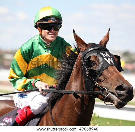 MELBOURNE - MARCH 13: Jockey Craig Williams on Flying Tessie before the start of the National Jockey Celebration, won by Be Positive at Flemington on March 13, 2010 - Melbourne, Australia. - stock photo