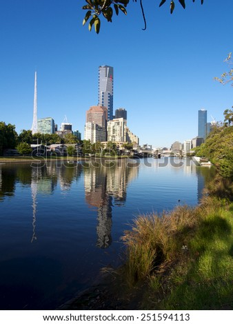 melbourne reflected in the yarra river on a bright summer morning