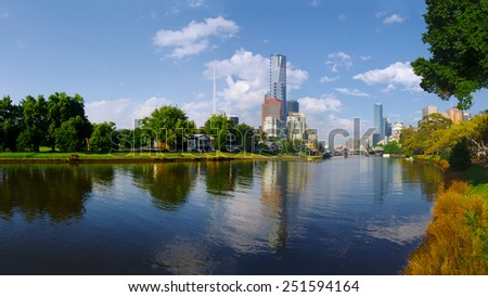 melbourne reflected in the yarra river on a spring morning - stock photo