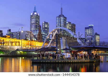 Melbourne's famous skyline from Southbank towards Flinders St Station in Melbourne, Victoria, Australia - stock photo