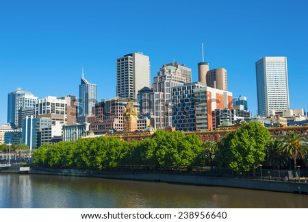 Melbourne skyline with skyscrapers and famous Flinders Streert train station seen across the river Yarra. Victoria, Australia - stock photo