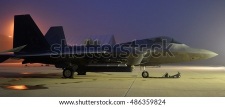 Melbourne, USA - March 21, 2015. Photo of an Air Force F-22 Raptor on a runway at sunrise on a civilian airfield in Melbourne, Florida.