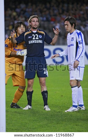 Melbourne Victory FC vs Gamba Osaka - Telstra Dome, 9th April '08 (#22 FUJIGAYA, Yosuke #22 WARD, Nick #7 ENDO, Yasuhito) - stock photo