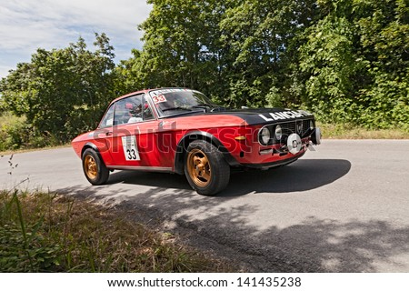 "MELDOLA, FC, ITALY - JUNE 2: unidentified drivers on a vintage racing car Lancia Fulvia 1.3 (1973) runs in rally for old cars ""VII Coppa citta' di Meldola"" on June 2, 2013 in Meldola (FC) Italy"