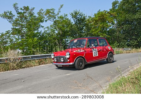 """MELDOLA, FC, ITALY - MAY 31: driver and co-driver on a red vintage Mini Cooper MK3 (1972) in classic car rally """"Coppa citt�¡ di Meldola"""" on May 31, 2015 in Meldola (FC) Italy - stock photo"""