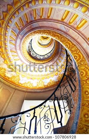 MELK, AUSTRIA - JUNE 21:  Imperial Stairs closeup in Melk Abbey. June 21, 2012 Melk, Austria.  Spiral Rococo staircase  leads from the library to the St. Peter and Paul Church in Melk Abbey. - stock photo