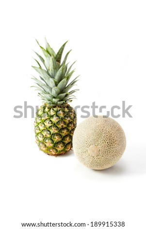 Melon and pineapple on white background - stock photo