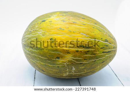 melon isolated on white wood table - stock photo