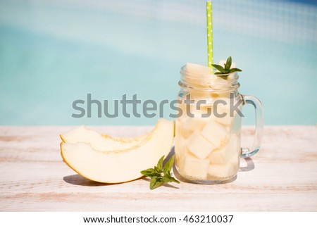 Melon juice in the jar on the wooden table