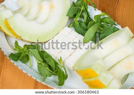 Melon slices with feta cheese and mint