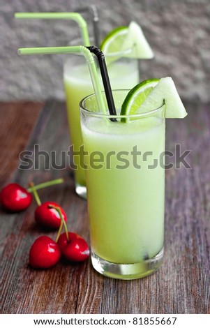 Melon smoothie on wooden table - stock photo