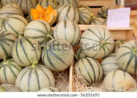 Melons on a market stall - stock photo