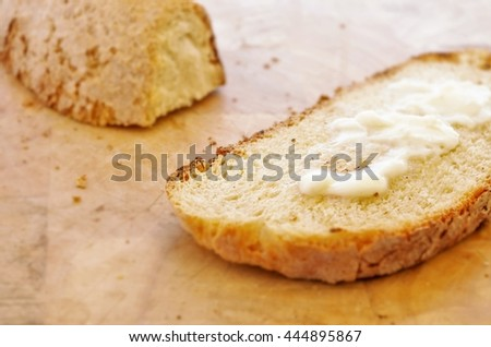 Melting butter on a slice of rustic toasted bread