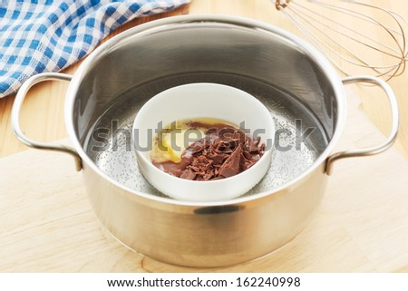 Melting chocolate in a hot water bath - stock photo