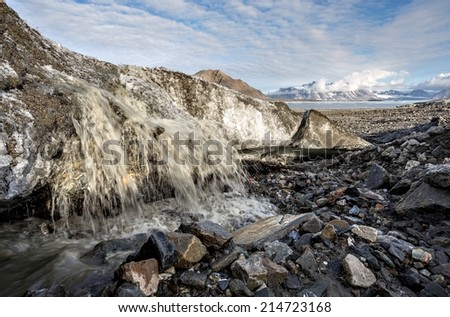 Melting glacier in the Arctic - Spitsbergen, Svalbard - stock photo