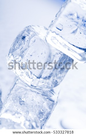 Melting ice cube tower on neutral background
