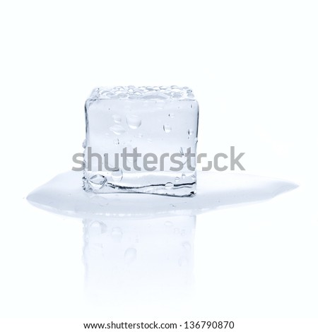 Melting ice cube with water drops isolated on white - stock photo