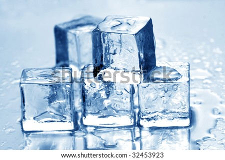 Melting ice cubes on a metal tabletop. blue reflective surface