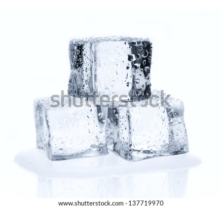 Melting ice cubes with water drops isolated on white - stock photo