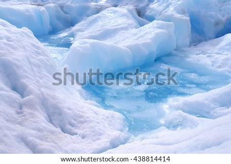 Melting ice on the glacier trekking trail. Perito Moreno Glacier. Argentina, South America - stock photo