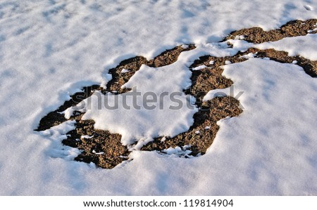 Melting Snow Revealing Ground Underneath - stock photo
