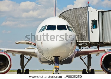 Member of ground crew is preparing airplane for next flight. - stock photo