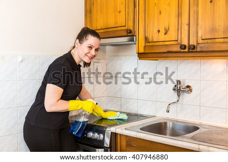 Member of housekeeping staff at work in the kitchen