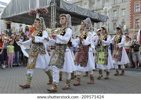 Members of folk group Albanian Culture Society Jahi Hasani from Cegrane, Macedonia during the 48th International Folklore Festival in center of Zagreb,Croatia on July 19,2014